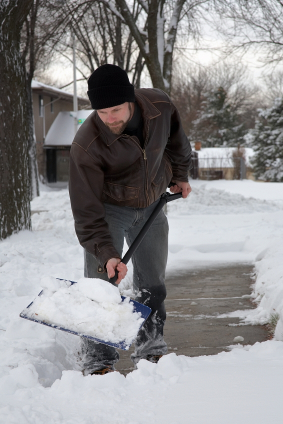 Man shovelling snow after a blizzard